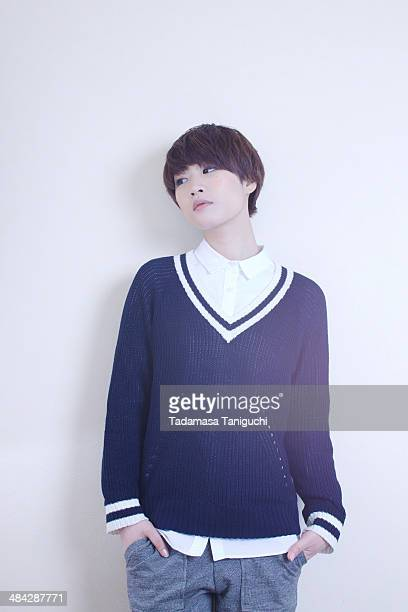 woman standing in favorite clothes - vネック ストックフォトと画像