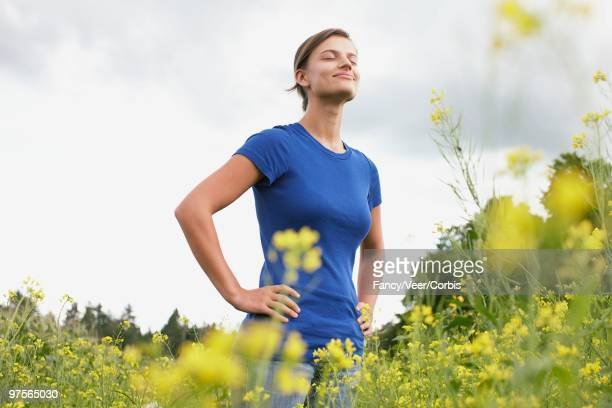 woman standing in field - wildnisgebiets name stock pictures, royalty-free photos & images