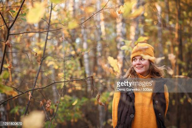 woman standing in forest during autumn,russia - russia stock pictures, royalty-free photos & images