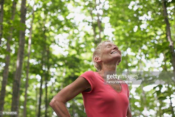 woman standing in forest - wildnisgebiets name stock pictures, royalty-free photos & images