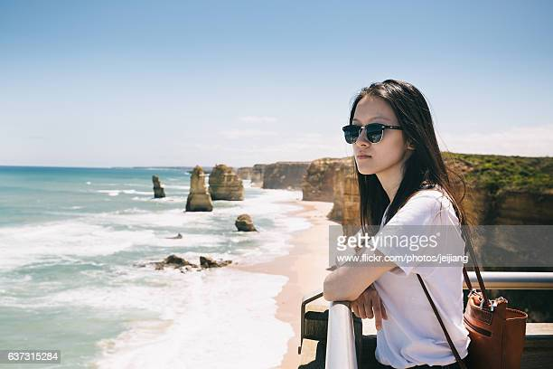 A Woman standing in front of 12 apostles