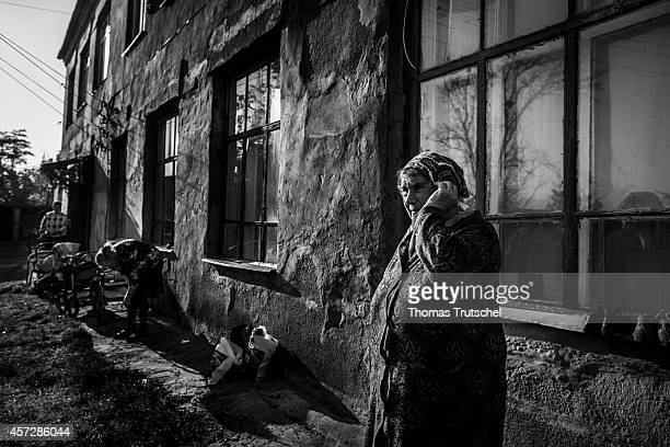 Woman standing in front of a shelter for refugees and internally displaced persons on October 14 in Chuhuiv Ukraine Currently about 40 internally...