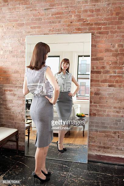 Woman standing in front of mirror
