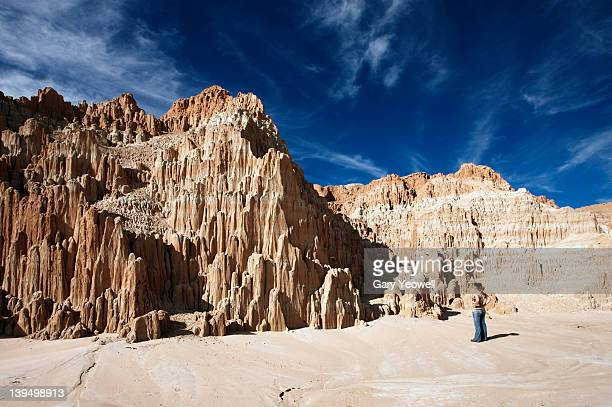 woman standing in front of sandstone formations - yeowell stock pictures, royalty-free photos & images