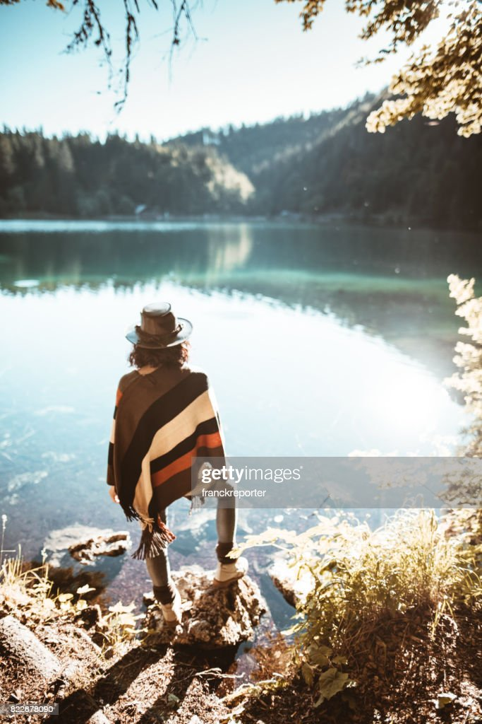 woman standing in front of the lake : Stock Photo