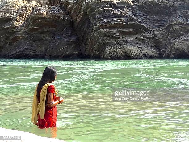 woman standing in ganges river - salwar kameez stock pictures, royalty-free photos & images