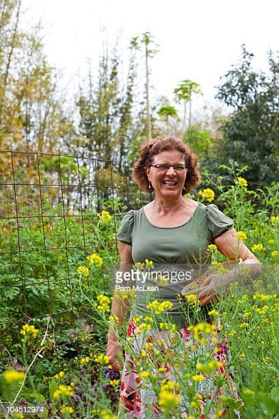 Woman standing in garden of edible flowers