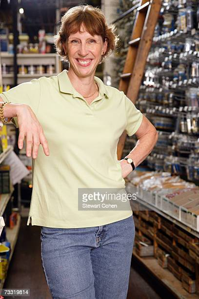 Woman standing in hardware store aisle, portrait
