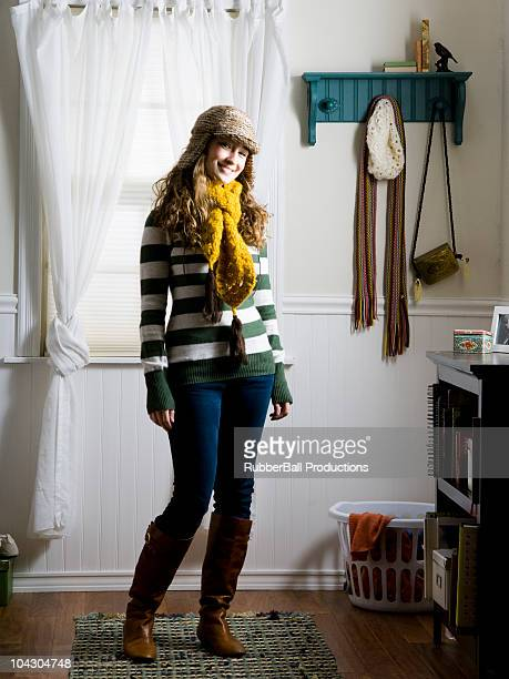 woman standing in her bedroom wearing a scarf