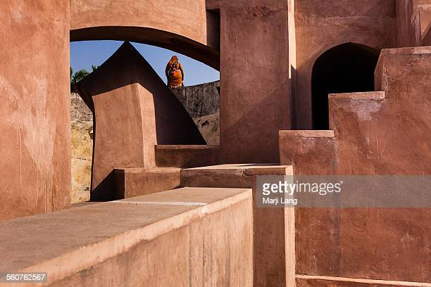 woman standing in jantar mantar observatory - new delhi stock pictures, royalty-free photos & images