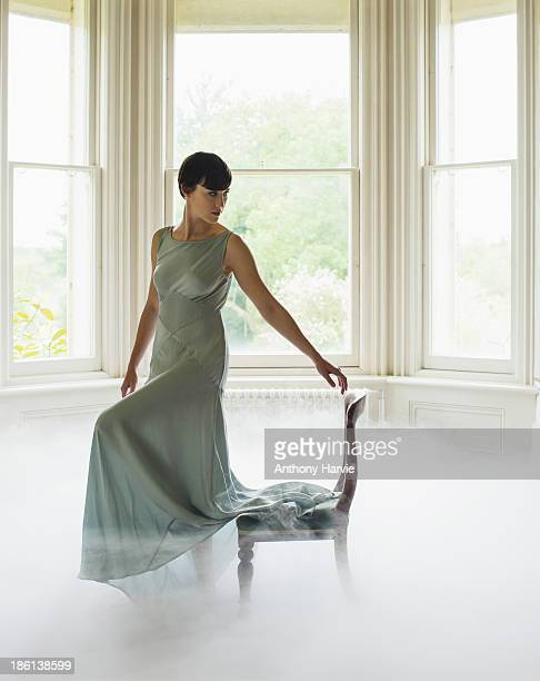 Woman standing in living room with misty floor