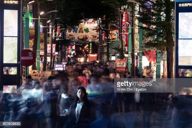 Woman Standing In Market At Night