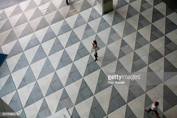 Woman Standing in Middle of Plaza