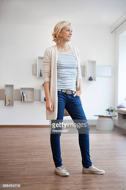 Woman standing in modern living room