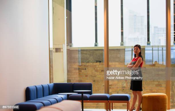 Woman standing in office.