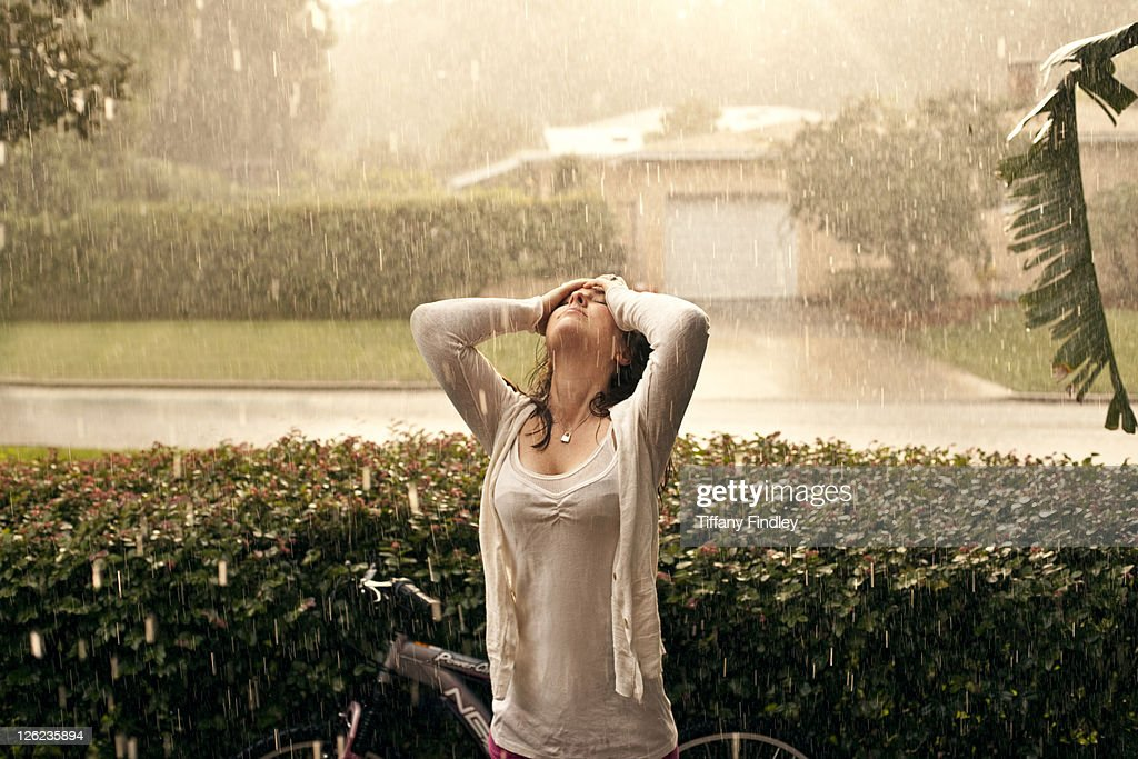 Unhappy woman standing in the rain - Free Stock Video - Mixkit
