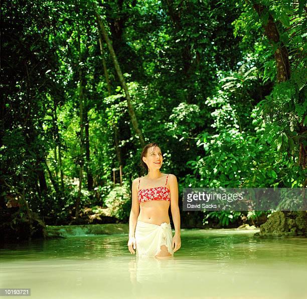 Woman standing in river, Dunn's River Falls, Ocho Rios, Jamaica