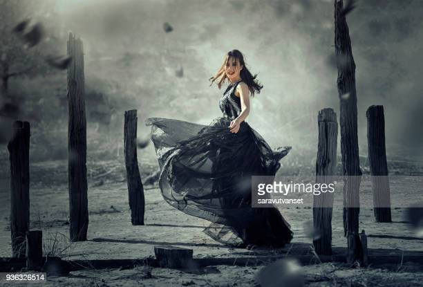 woman standing in rural landscape, thailand - evening gown stock pictures, royalty-free photos & images