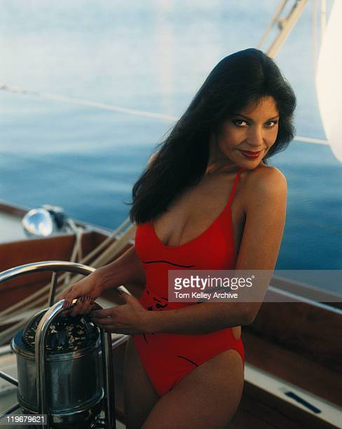 woman standing in sailboat, smiling, portrait - swimwear photos stock photos and pictures