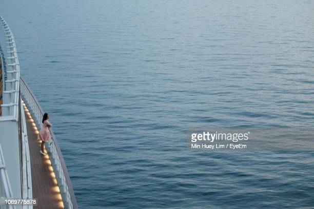 woman standing in ship on sea - passagerarbåt bildbanksfoton och bilder