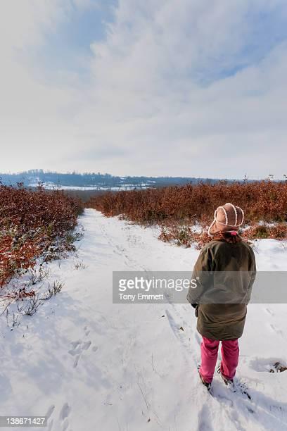 woman standing in snow - deux sevres fotografías e imágenes de stock