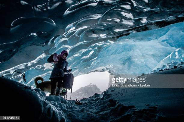 woman standing in snowy cave - columbia icefield stock pictures, royalty-free photos & images