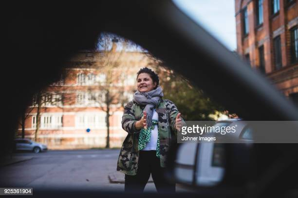 woman standing in street - malmo stock pictures, royalty-free photos & images