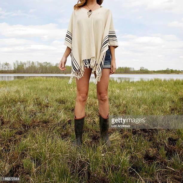 Woman standing in summer marsh