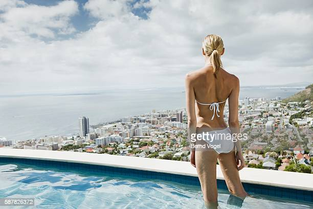 Woman standing in swimming pool