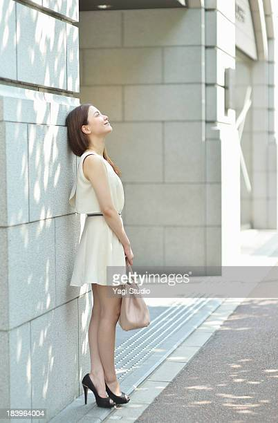 woman standing in the city of kyoto - sleeveless stock pictures, royalty-free photos & images