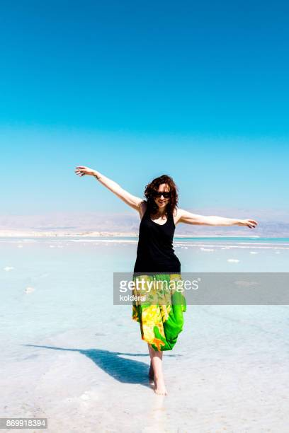 Woman standing in the shallow water of the Dead Sea