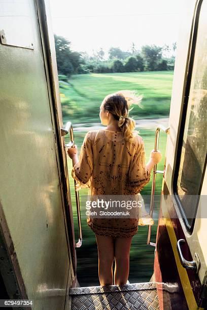 Woman standing in the train door