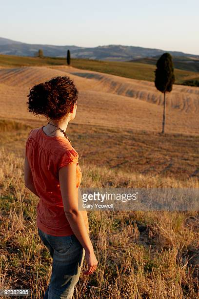 woman standing in tuscan landscape - yeowell stock pictures, royalty-free photos & images