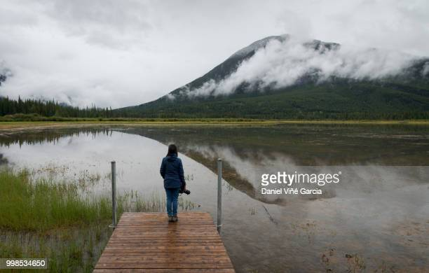 Woman standing in Vermilion lakes, Banff National Park.