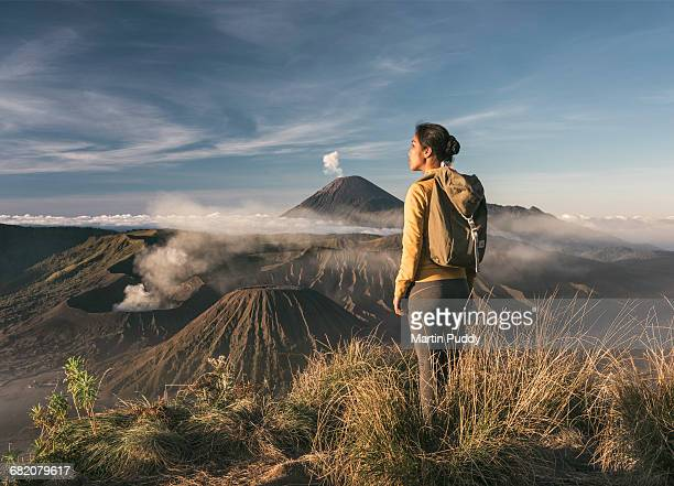 woman standing infront of mount bromo - mt bromo stock photos and pictures