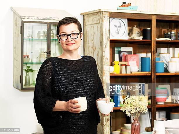woman standing inside a shop