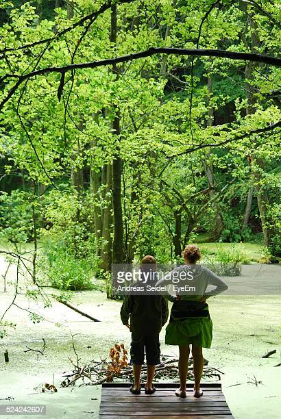 woman standing near a swamp with her son - swamp stock pictures, royalty-free photos & images