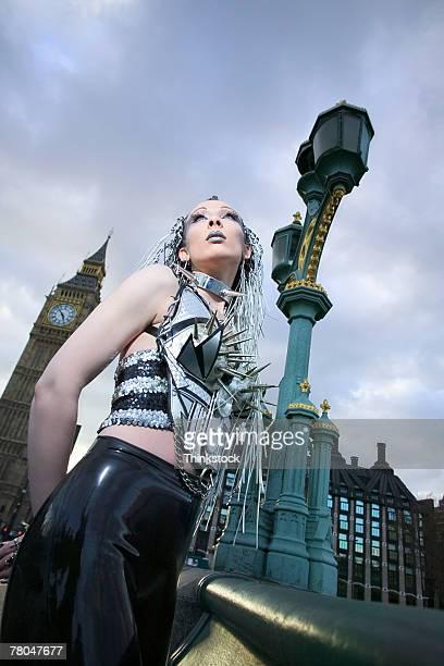 woman standing near big ben, london - punk rock ストックフォトと画像