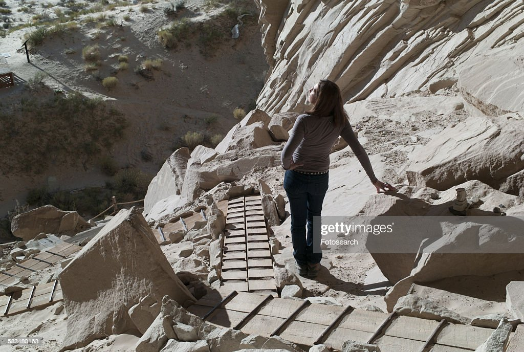 Woman standing near cliffs : Stock Photo