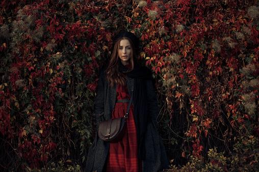 Woman standing near ivy - gettyimageskorea
