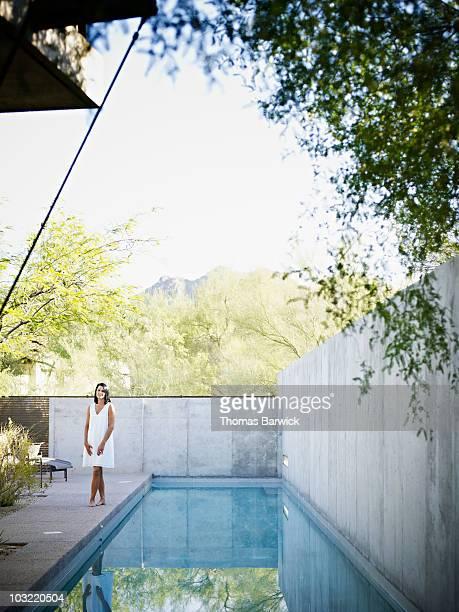 Woman standing near pool in courtyard