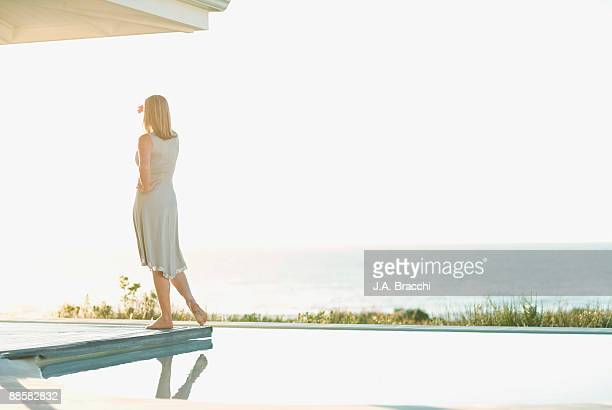 Woman standing near swimming pool