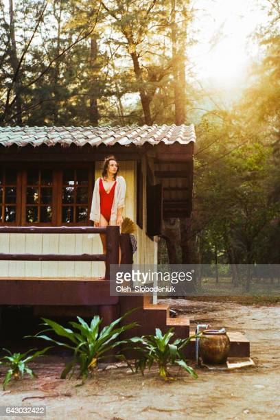 Woman standing near the house