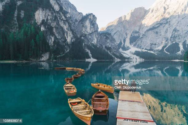 woman standing near the lake lago di braies  in dolomites - switzerland stock pictures, royalty-free photos & images