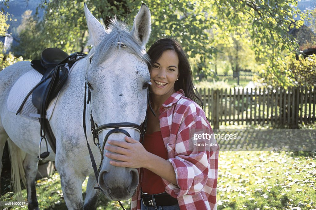 Woman standing next to horse : Stock Photo