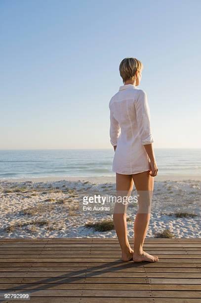 Woman standing on a boardwalk