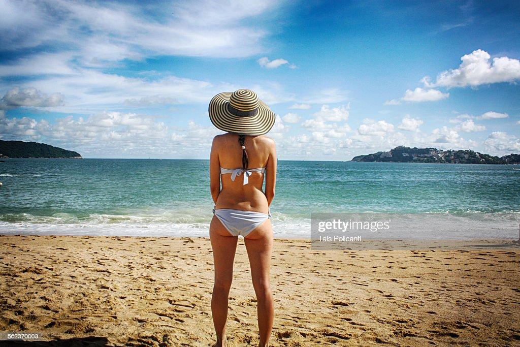 Woman standing on a Caribbean beach : Stock Photo