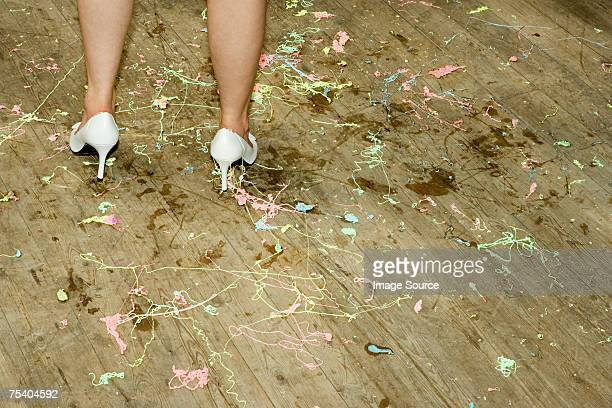 Woman standing on a messy floor