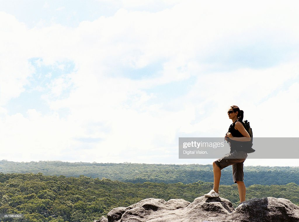 Woman Standing on a Mountain Summit Looking at View : Stock Photo