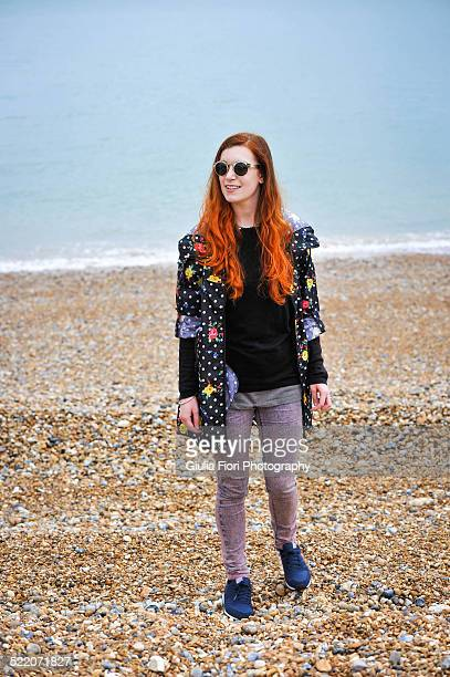 Woman standing on a pebble beach